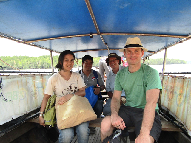 Jim Pettiward (green shirt) and MAP staff on the longtail boat to Klang Island