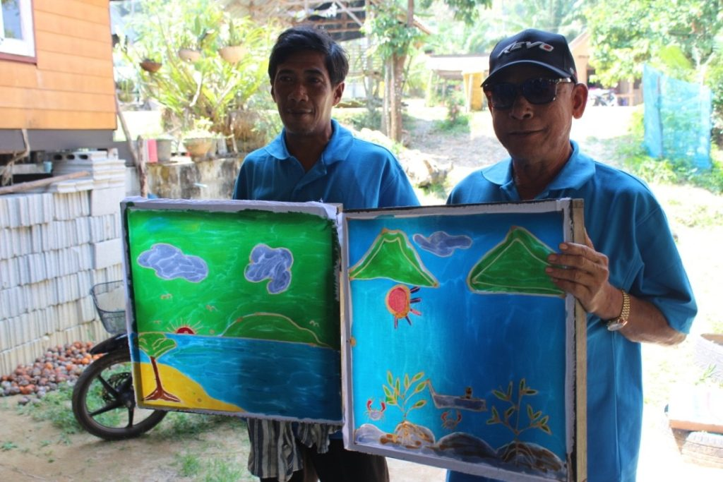 Two participants showing off their own handmade Batik prints made at Ban Talae Nok. March 9th, 2017.
