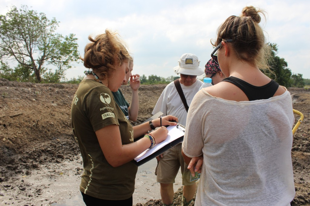 … while a 2nd group surveys marine benthos such as snails and crabs. Both groups use a checklist of species found on site.