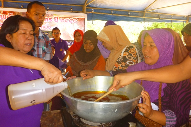 "Community members were shown how to make the products by ""getting their hand dirty""! Here, they were busy helping in the cooking phase which involved a lot of steering."