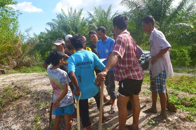 MAP staff discussing hydrology strategy with local village workers