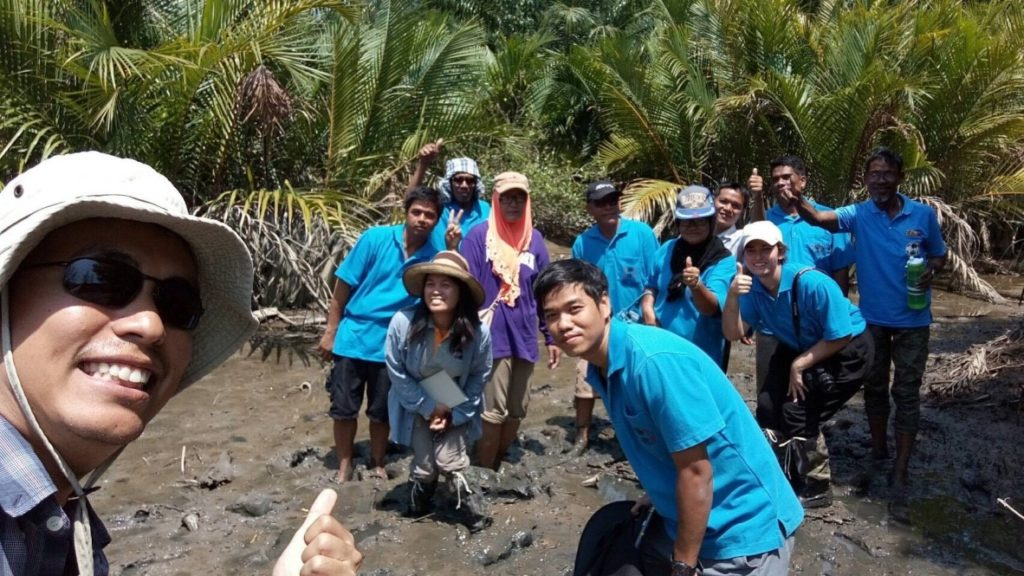 "A group ""selfie"" in the Mangrove Restoration Site at Ban Talae Nok. March 9th, 2017."